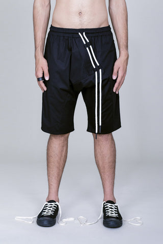 COTTON DRAWSTRING ASYMMETRIC SHORTS