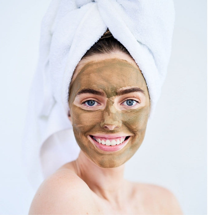 Caucasian girl wearing nature talk's Australian made, natural cleansing australian green clay and matcha mask complete skin care