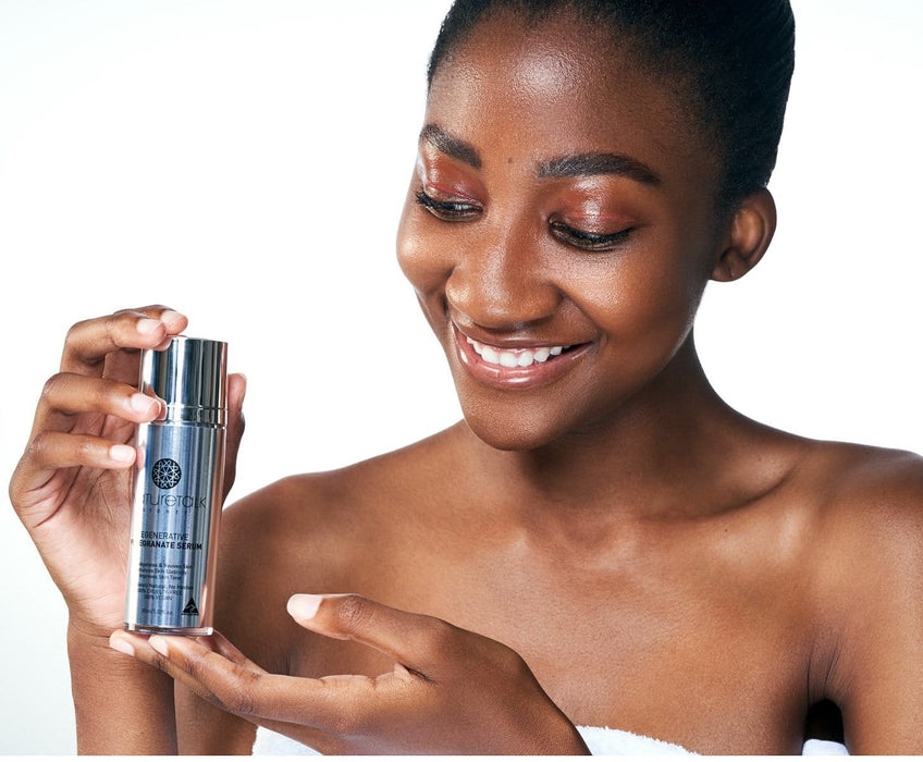 african girl holding nature talk's regenerative pomegranate serum Australian made, natural complete skin care and nourishment