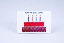 Load image into Gallery viewer, A birthday cake with 4 lit candles & greeting on top