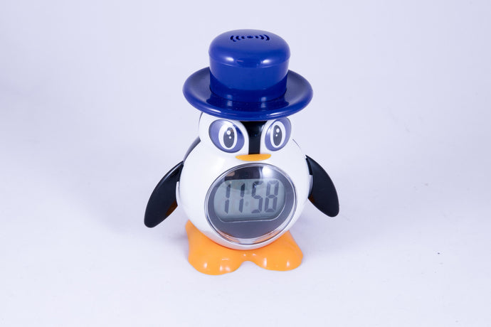 A penguin wearing a tophat w/ clock display at stomach