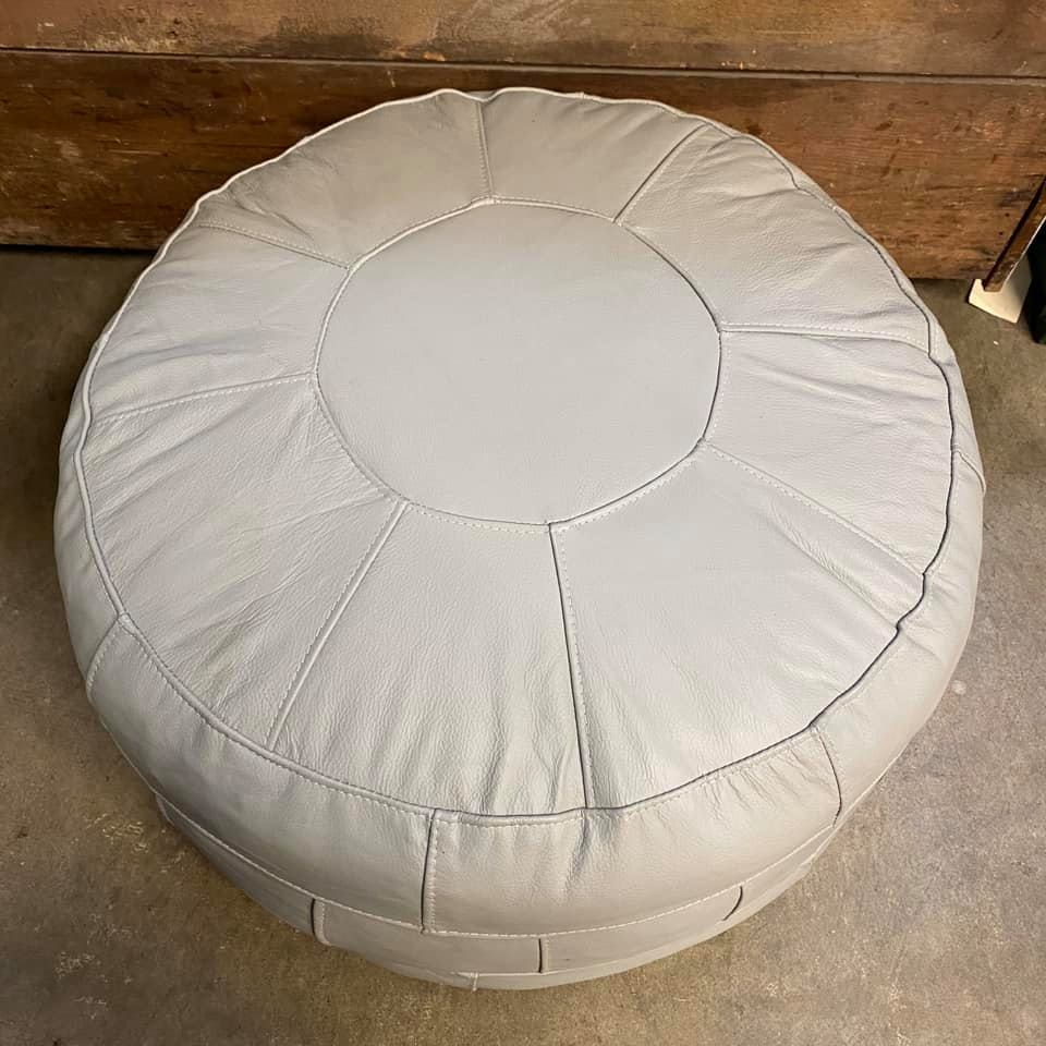 cream leather ottoman