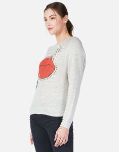 Nyla Arrow Lip Raglan Pullover