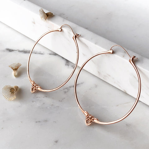 ethically made minimalist hoop earrings in rose gold.