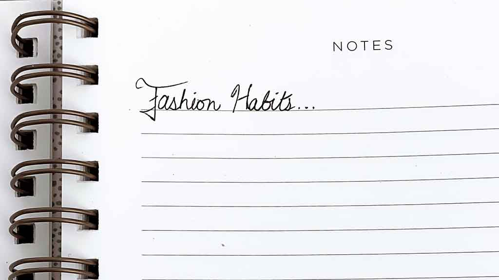 """Spiral Notebook with the words """"fashion habits"""" written in cursive"""