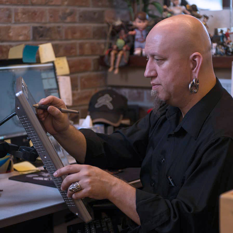 Sculptor Tomas Wittelsbah digital sculpting in 3D using a stylus pen on a large tablet screen