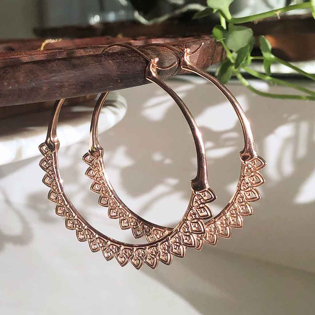 ethical rose gold hoops with intricate details