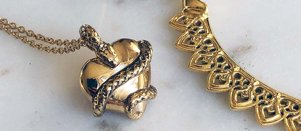 Astor + Orion Ethical Jewelry made from recycled metals. Gold heart snake charm necklace