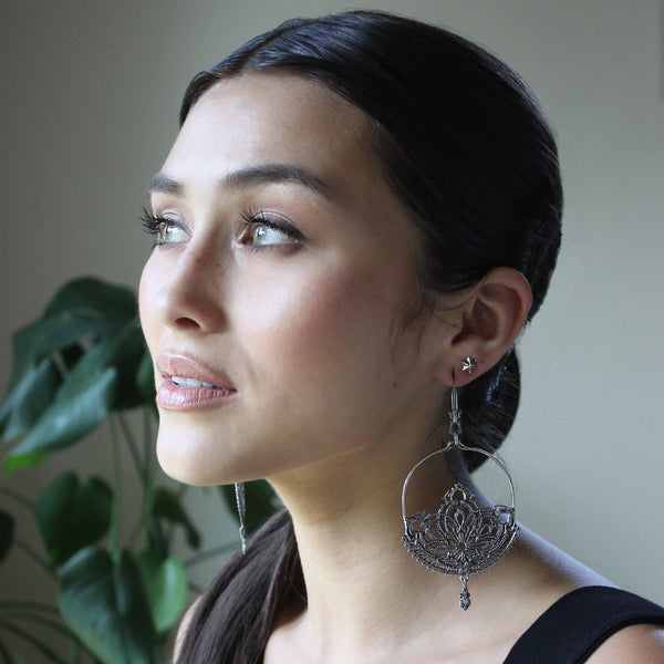 Astor + Orion Lotus Statement earrings in silver. Online Bohemian jewelry brand selling big earrings with cool designs.