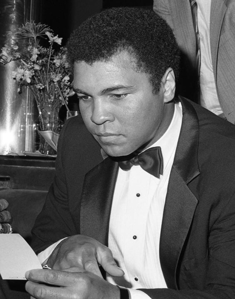 A Serious Muhammad Ali Reading - Global Images Gallery