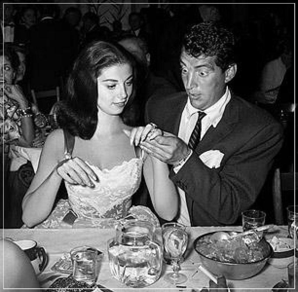 Dean Martin Looks At Pier Angeli's Ring, taken in Beverly Hills, 1955 by Frank Worth.