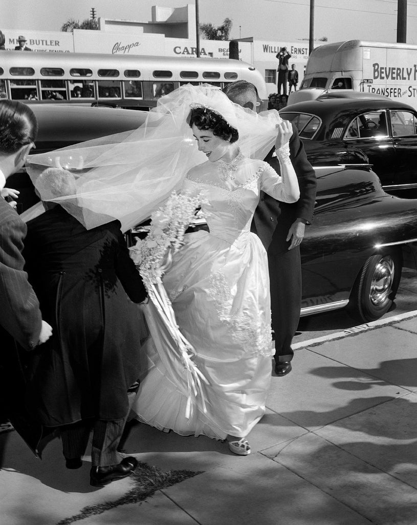 Elizabeth Taylor Fixes Train of First Wedding Dress by Frank Worth Photography-Global Images-Global Images