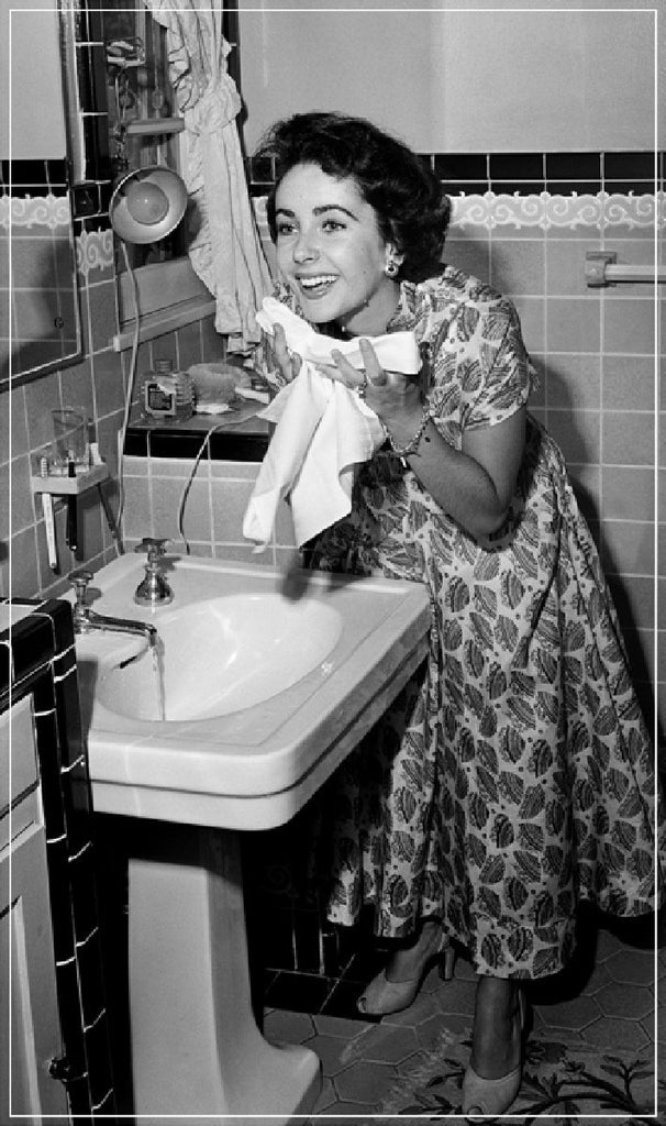 Elizabeth Taylor Washing Face by Frank Worth Photography