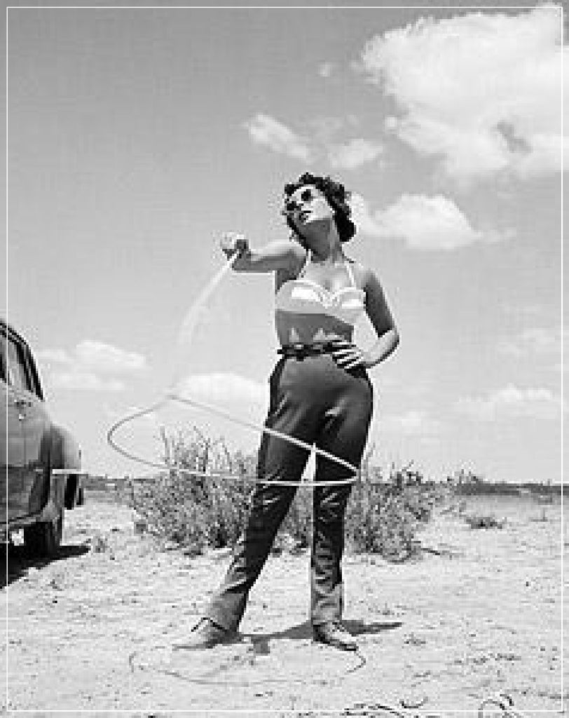 Elizabeth Taylor With Lasso taken on set of GIANT by Frank Worth Photography