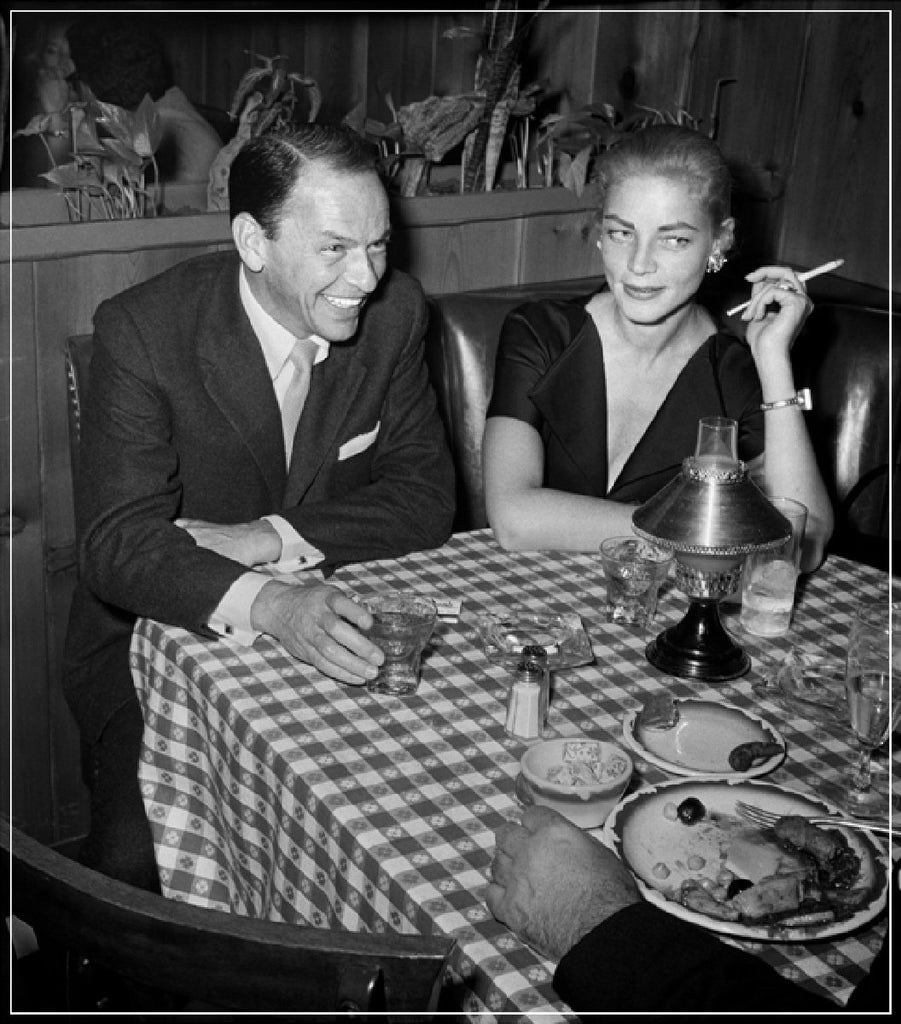 Frank Sinatra And Lauren Bacall At Dinner by Frank Worth Photography