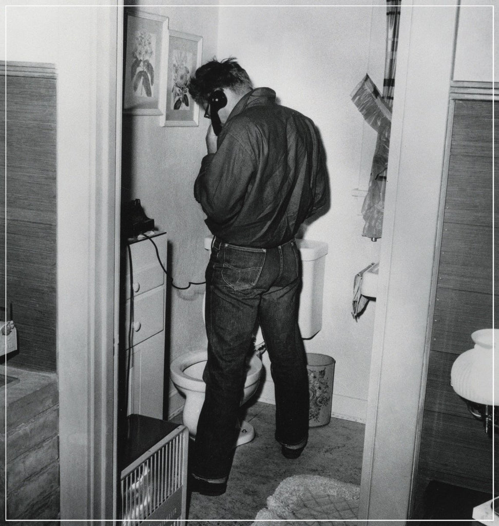 James Dean In Restroom by Frank Worth Photography
