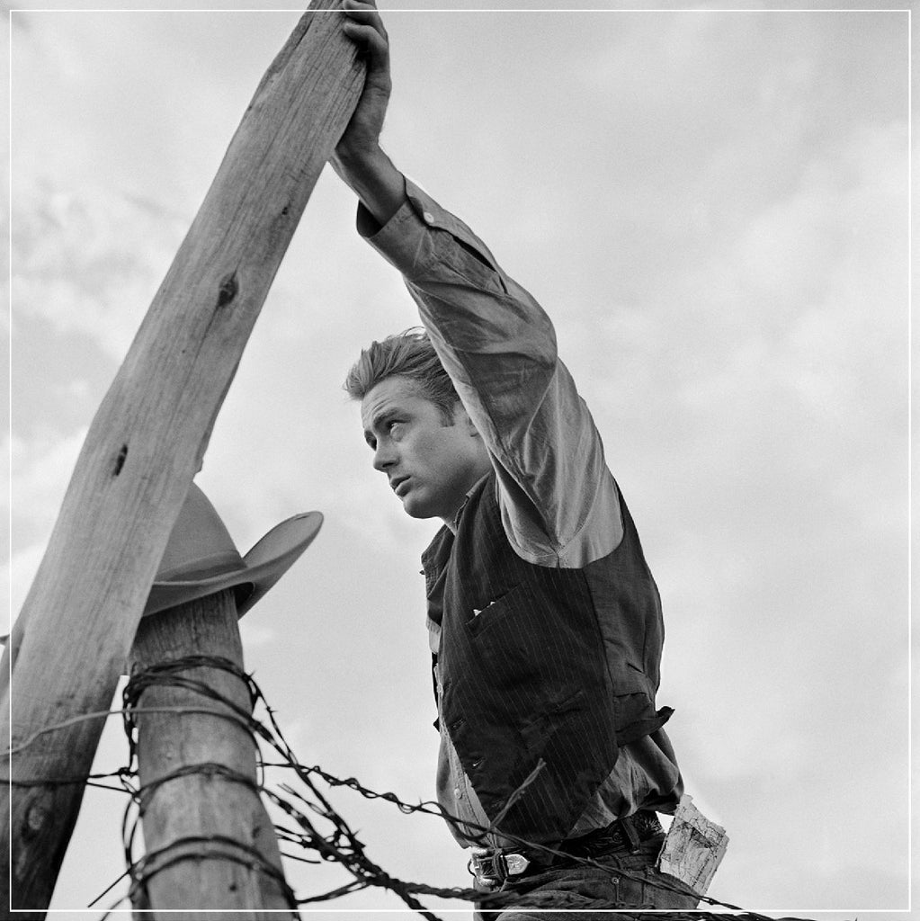 James Dean Leaning On Fence by Frank Worth Photography on the set of GIANT in 1955