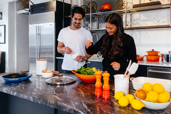 Couple cooking with CBD at home kitchen