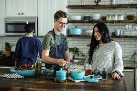man and woman cooking with cbd oil