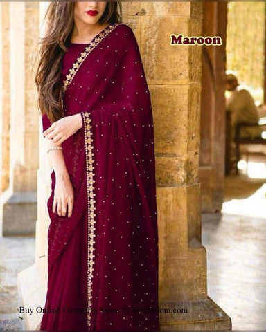 Trishulom Maroon Colored Net Embroidered Saree