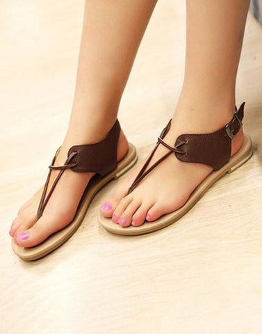 Exposed Brown Buckle Flats