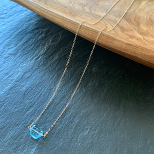 Tiny Solitaire: Blue Topaz  on Gold