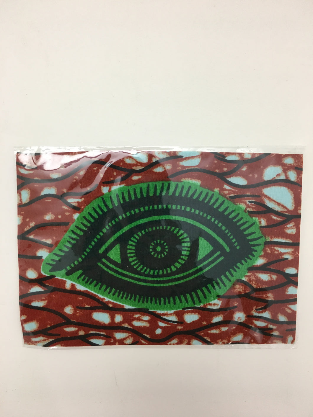 Green Eye on Red Cloth Patch