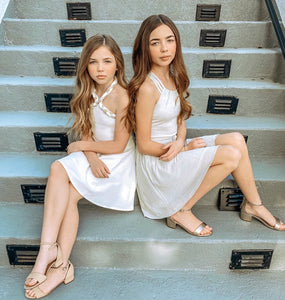 Gracie and Lilly wearing the Olivia White and the Ariana Silver! Both on sale now!