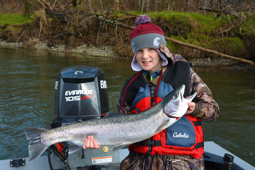 The Author's son Ryan with a winter steelhead he picked up in a small seam.jpg