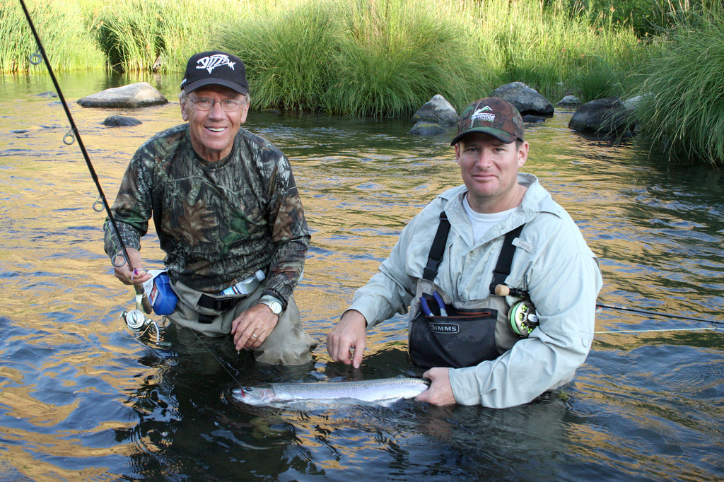 The author's father, Jerry Haugen, and guide Jeremy Toman, worked together in the shadows of a setting sun to pull this mid-summer steelhead from the Deschutes River.
