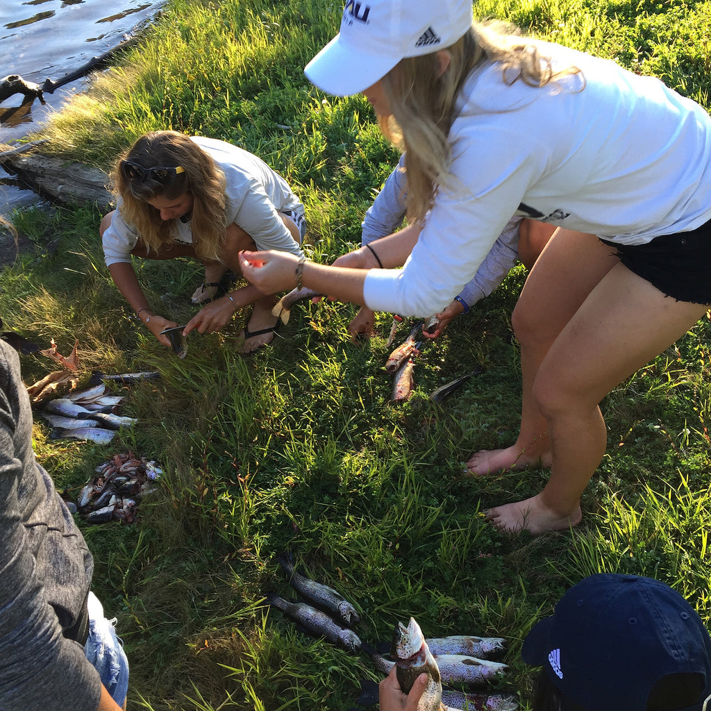"<p class=""p6"">A fun afternoon of trout fishing on the river with members of Northern Arizona University's women's golf team culminates with them cleaning and cooking their catch.</p> <p class=""p7""> </p>"