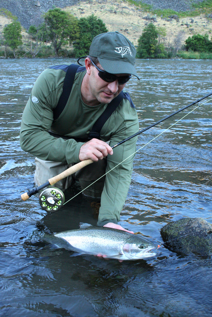 "No matter what gear you use, knowing where it's best fished is important.<span class=""Apple-converted-space"">  </span>Scott Haugen is smiling over this summer steelhead he plucked from a bedrock shelf."