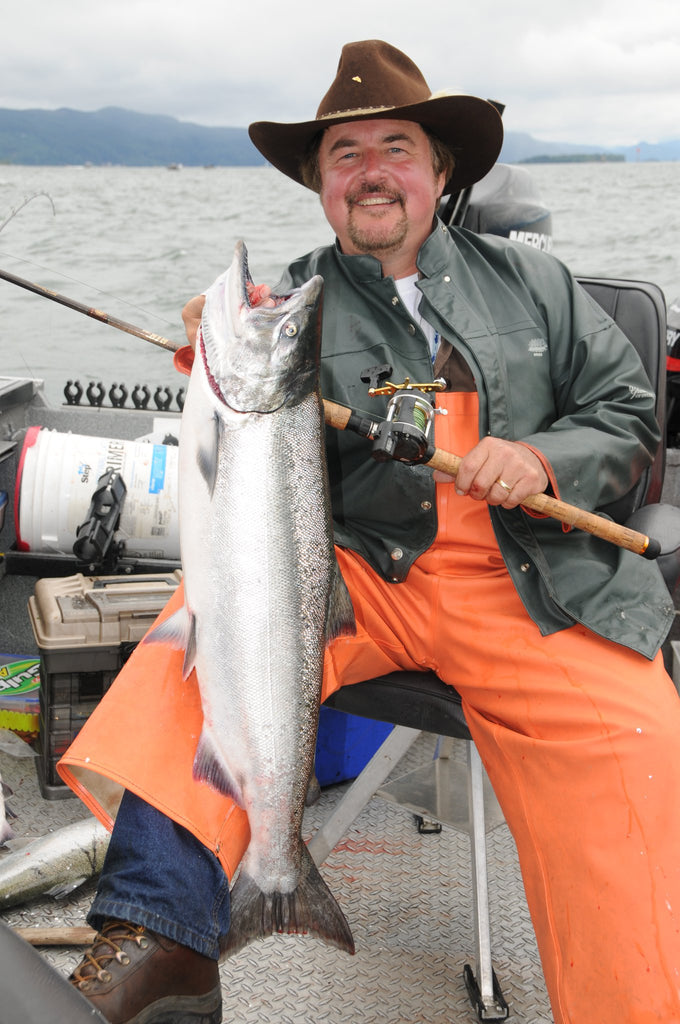 buzz ramsey holding a salmon fishing