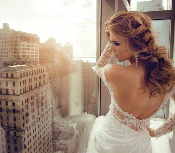 bride wearing clip in hair extensions