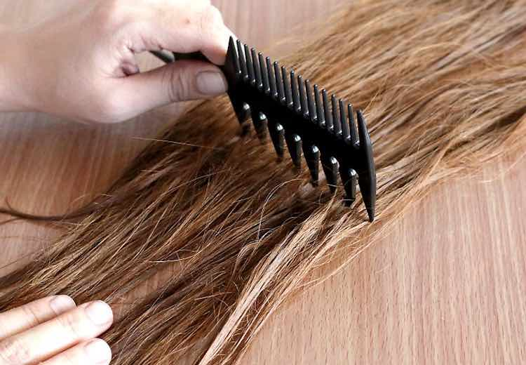 Wide tooth comb to tangled hair