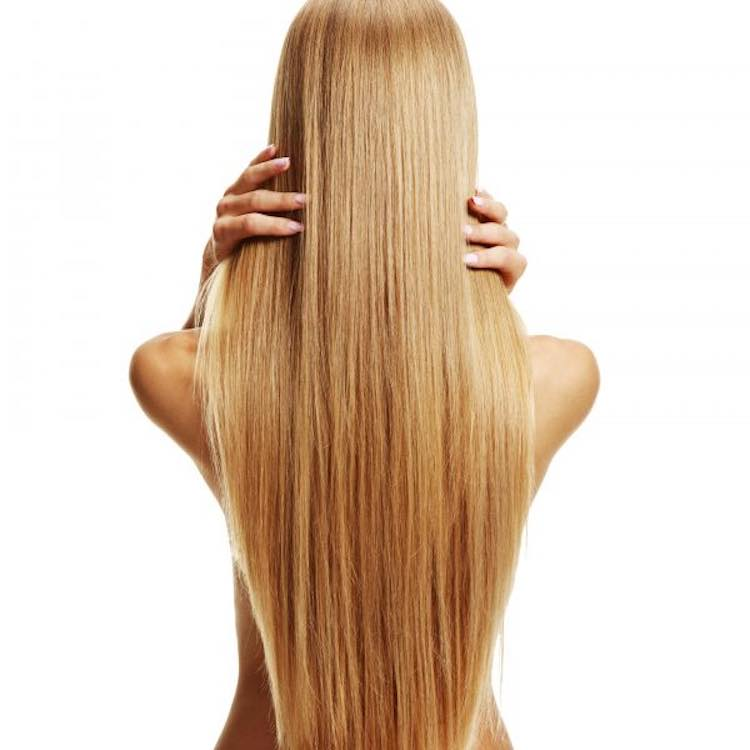 long blonde clip-ins hands in hair