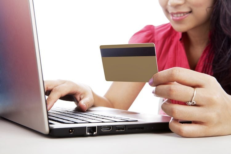 woman-shopping-online-laptop-credit-card-hair-business