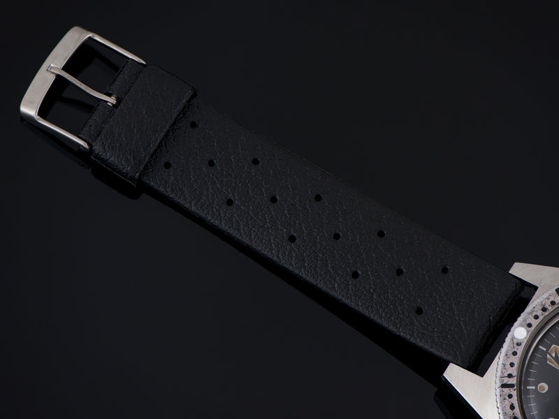 Brand new old stock rubber black strap with matching silver tone buckle