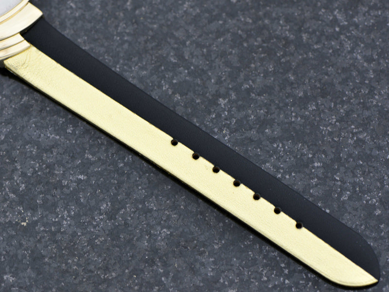Brand New Reissue Gold Black Band to match the original, with matching gold tone buckle