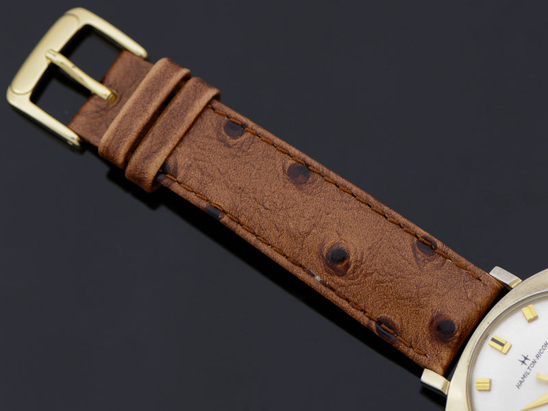 Brand new genuine leather Brown Ostrich Grain Band with matching Gold Colored Buckle