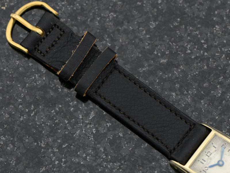 Brand New Old Stock Genuine Pigskin Black Watch Band with matching Gold Colored Buckle