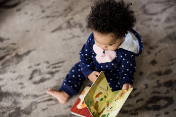 infant girl reading