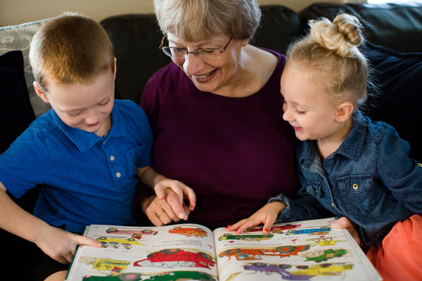 grandma reading with two children