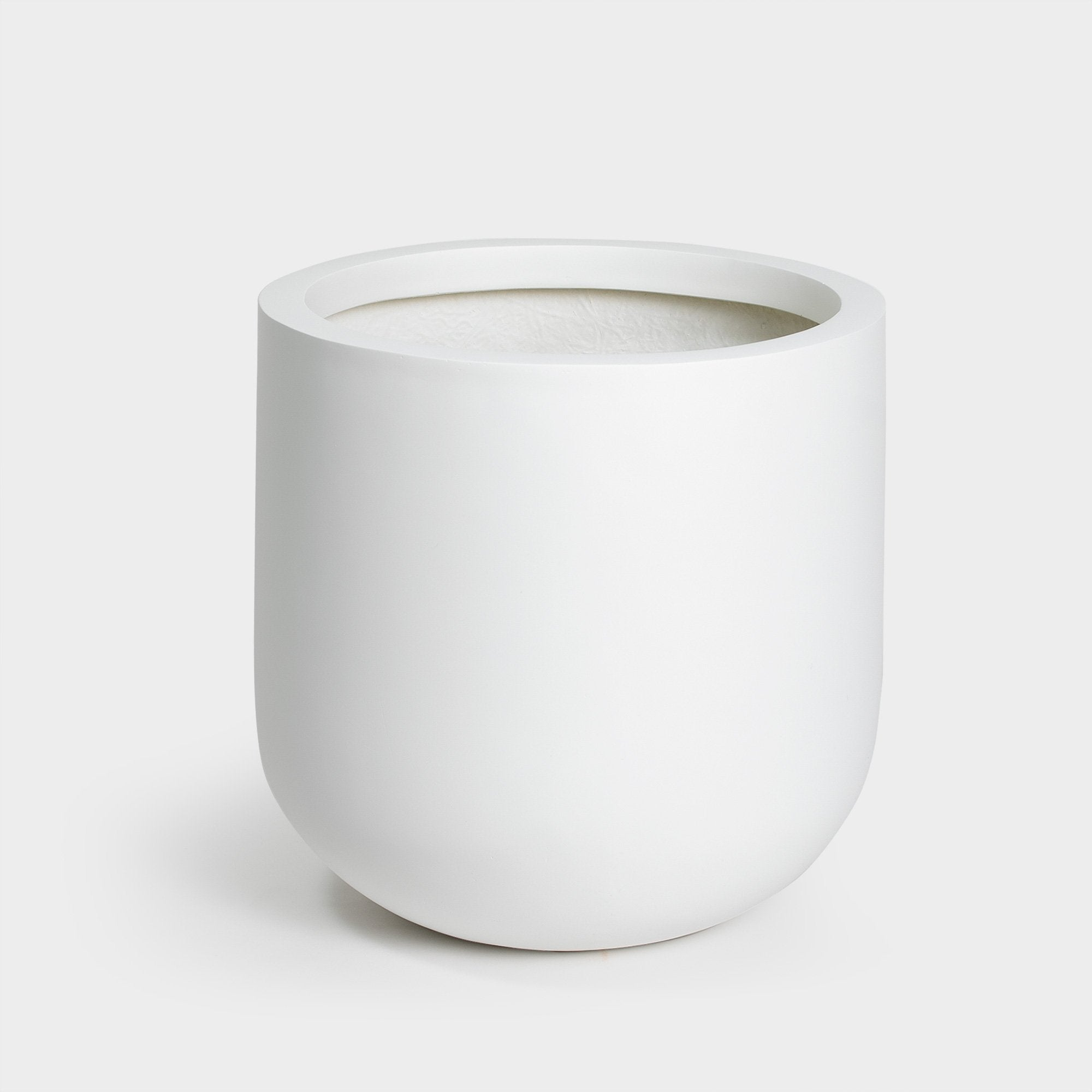 White large planter with curved bottom for plants in 14