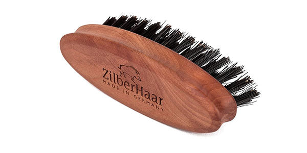 Get a good beard or comb brush