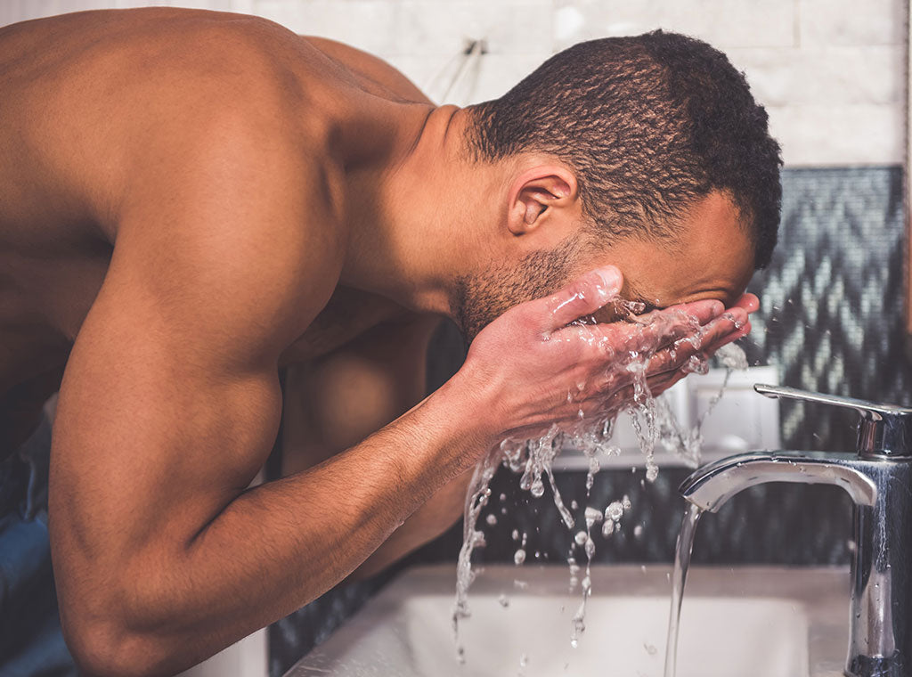 Man washing his face