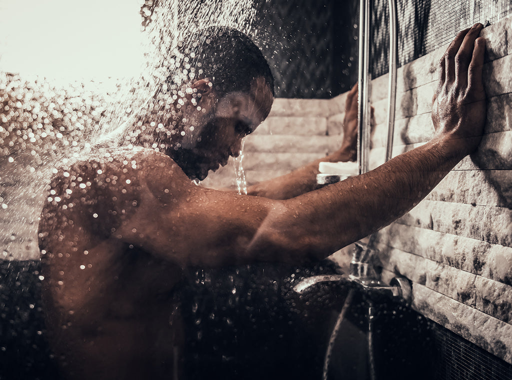 Man taking a shower with a beard