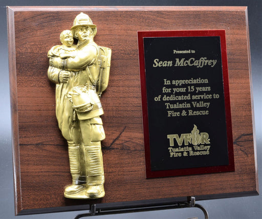 Firefighter Holding Child Plaque