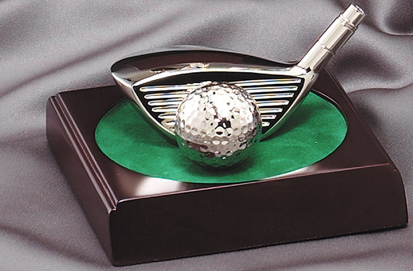 Golf Driver and Ball on Green
