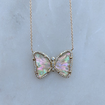 Butterfly Necklace With Tourmaline and Pearl on Marble